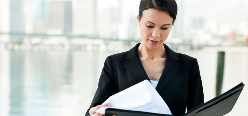 Businesswoman with Folio by Bay  [url=http://www.istockphoto.com/file_search.php?action=file&lightboxID=4096051][img]http://www.erichood.net/bizpeep.jpg[/img][/url]